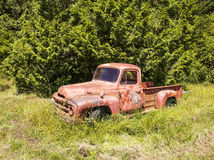 Red Truck By Forest Stock Photo