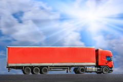 Red truck goes on way Royalty Free Stock Photography