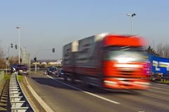 Red truck at high speed Royalty Free Stock Photo