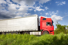 Red truck on highway Royalty Free Stock Image