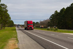 Red truck on highway Royalty Free Stock Images