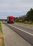 Red truck on highway Stock Images