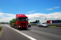 Red Truck Moving Fast Stock Photos