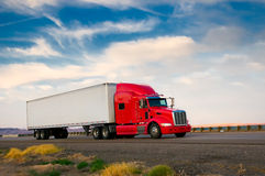Red truck moving on a highway Stock Image