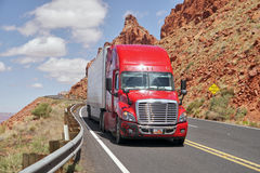 Free Red Truck On The Road And Rocks In The Background. Royalty Free Stock Photo - 73122845