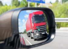 Truck reflection in a car mirror Stock Images