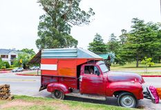 MONTEVIDEO, URUGUAY, USA - DECEMBER 12, 2017: Red truck on the road. With selective focus stock photography