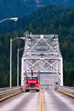 Red truck on a silver bridge Royalty Free Stock Images