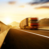 Red truck traveling at high speed Royalty Free Stock Image