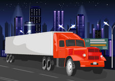 Red truck with white cargo container goes through night city Stock Photography