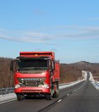 red truck on a winter road. Royalty Free Stock Image