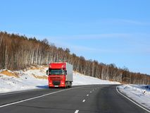 red truck on a winter road. Stock Photo