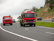 Red trucks on the road Stock Photography