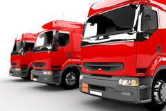 Three red transport trucks Royalty Free Stock Image