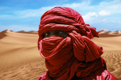 Red tuareg. TIMBUKTU, MALI Red turban Tuareg desert dunes near Timbuktu in Mali stock image