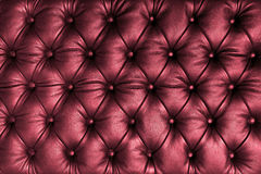 Red tuffted leather with buttons. A background of tufted red leather, with decorative buttons Royalty Free Stock Photography