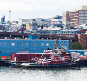 Red Tug on Blue Building Royalty Free Stock Photos