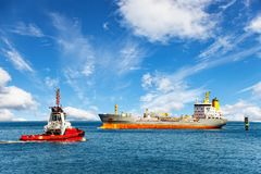 Tugboat and ship Stock Photography