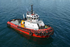 Red tug boat on  water Stock Image