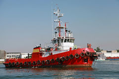 Red tug is underway on Black sea Royalty Free Stock Image