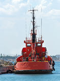 Red tugboat. Stock Photo