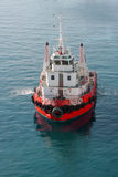 Red tugboat in sea. High angle view of modern red tugboat sailing in sea Royalty Free Stock Photography