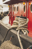 Red Tugg boat ropes. Large tug boat tie up in a harbor on Lake Michigan Royalty Free Stock Image