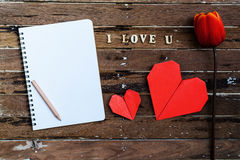 Red tulip with blank notebook and red heart shape Stock Images