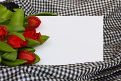 Red tulips with blank invitation card Royalty Free Stock Photo