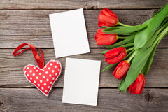 Red tulips, blank photo frames and heart Royalty Free Stock Photo