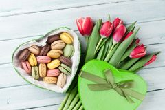 Red tulips bouquet and gift box with macaroons Royalty Free Stock Photography