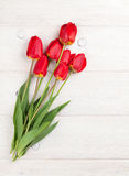 Red tulips bouquet over wood Stock Photography