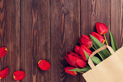 Red tulips bouquet in paper bag Royalty Free Stock Image