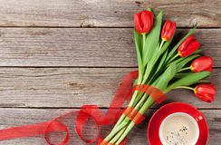 Red tulips and coffee cup Stock Photo