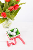 Red tulips and gift box royalty free stock photography