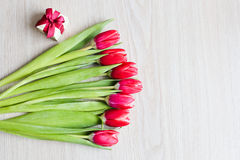 Red tulips and gift box with red bow Royalty Free Stock Photography