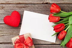 Red tulips, gift box and Valentine`s day greeting card royalty free stock photo