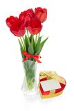Red tulips and a gift box Stock Photography