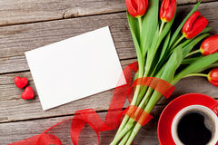 Red tulips, greeting card and candy hearts Stock Images