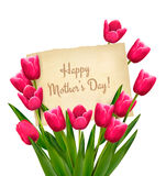 Red tulips with Happy Mother's Day note. Royalty Free Stock Photo