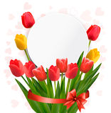 Red tulips with Happy Mother's Day note. Stock Photo