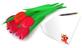 Red tulips and love letter on a white background. Stock Photos