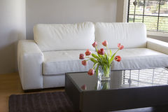 Red tulips in modern living room - home decor Royalty Free Stock Photography