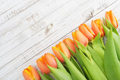 Red tulips over wooden background Royalty Free Stock Image