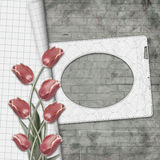 Red tulips and paper frame on a brick wall background Royalty Free Stock Photography