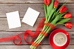 Red tulips, photo frames and coffee cup Stock Images