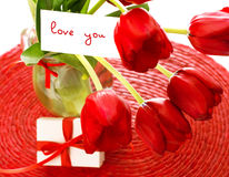 Red tulips with postcard Stock Photography