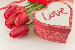 Red tulips and a present box Royalty Free Stock Photography