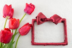 Red tulips on a silk fabric Royalty Free Stock Images