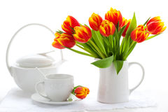 Red tulips and tea Royalty Free Stock Photo